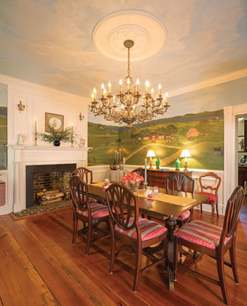 Painted scenes of Ben Lomond and Tappahannock as they appeared in the 1700s adorn the walls of the formal dining room. Photography by Roger Foley.