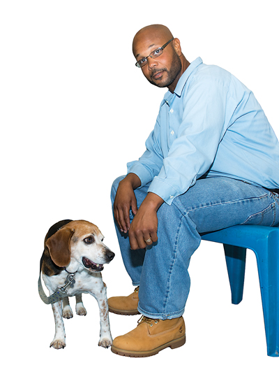 Bruce Diggs recently worked with Ernie (a beagle with some trust issues) at Lunenberg Correctional Center. The dogs in the Pen Pals program sleep in crates in the offenders' cells to get hands-on training and companionship around the clock.
