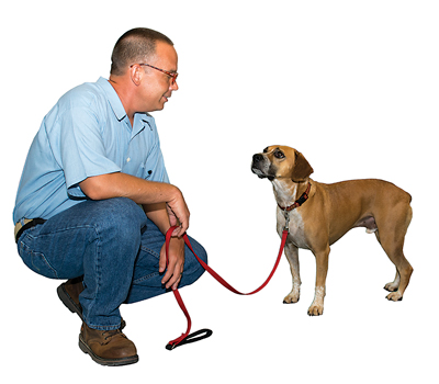 Jon Ganz, shown with Timber, has trained about fifteen dogs through the program.