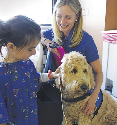 Margaret Popik and Elsa, volunteers with Dogs on Call, visit patients in most VCU Medical Center buildings and some off-site locations.