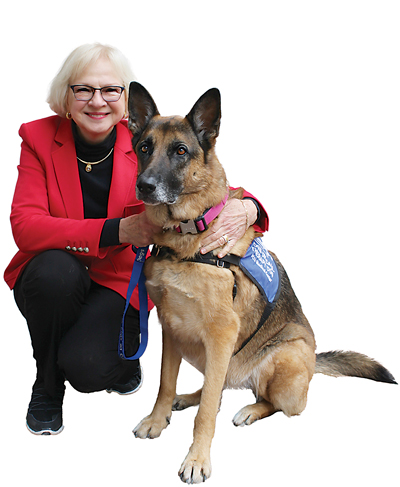 Ready for duty! Dr. Sandra Barker, professor of psychiatry and director of the Center for Human-Animal Interaction, and Dahlia.